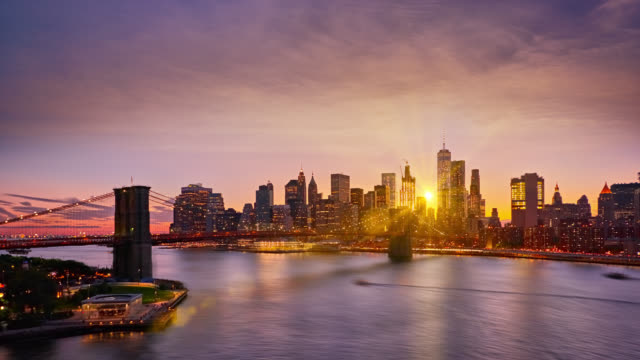 senset over manhattan business district - sunset stock videos & royalty-free footage