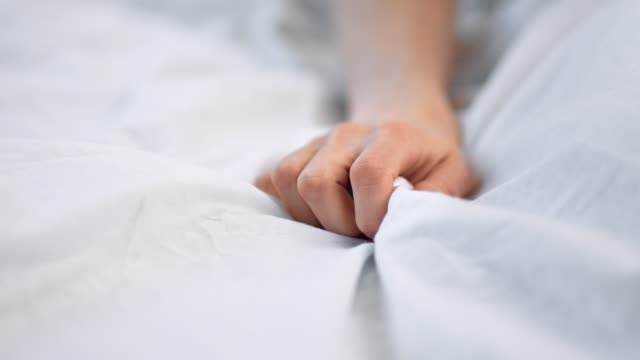 Sensual lady hand compressing white sheets feel desire and enjoyment. 4k Dragon RED camera Sensual lady hand compressing white sheets feel desire and enjoyment. Sexual feminine arm touch blanket during foreplay having intimate tenderness. 4k Dragon RED camera blanket stock videos & royalty-free footage
