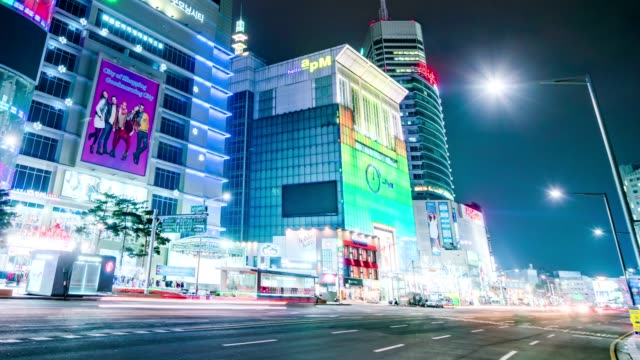 Seoul City Night Shopping Area Timelapse Timelapse of Dongdaemun shopping area in Seoul. Busy lightings, shoppers and traffics. Tight shot. korea stock videos & royalty-free footage