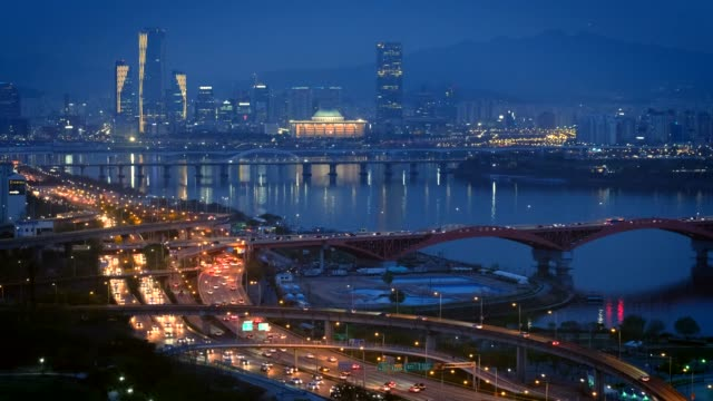 Seoul cityscape in twilight, South Korea. Aerial view of Seoul downtown cityscape and Seongsan bridge over Han River in twilight. Seoul, South Korea. seoul stock videos & royalty-free footage