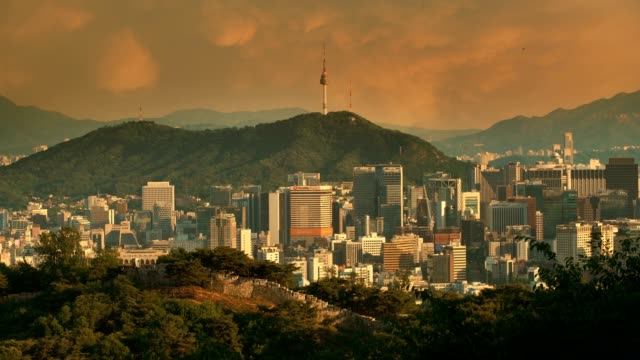 Seoul downtown cityscape with fortress and Namsan Seoul Tower on sunset Seoul, South Korea. namsan seoul stock videos & royalty-free footage