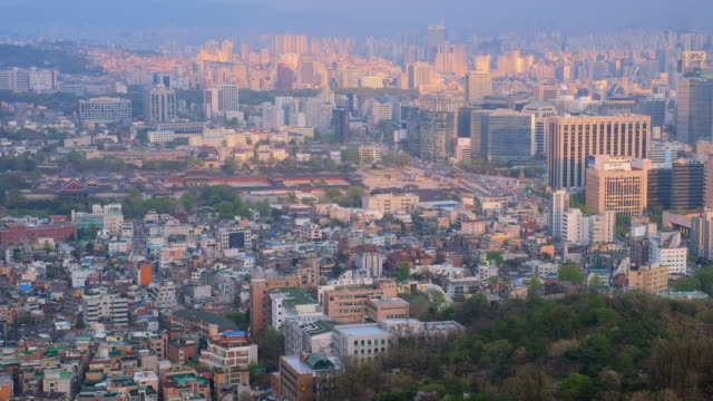 Seoul skyline and Gyeongbokgung Palace on sunset, South Korea. Aerial view of Seoul downtown cityscape with Gyeongbokgung Palace on sunset from Inwang mountain. Seoul, South Korea. gyeongbokgung stock videos & royalty-free footage
