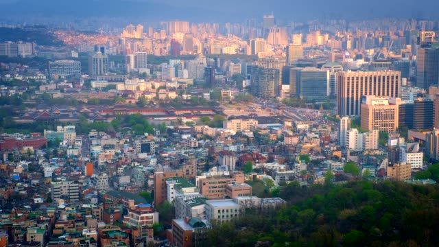 Seoul skyline, South Korea. Seoul downtown cityscape and Gyeongbokgung Palace on sunset view from Inwang mountain. Seoul, South Korea. gyeongbokgung stock videos & royalty-free footage