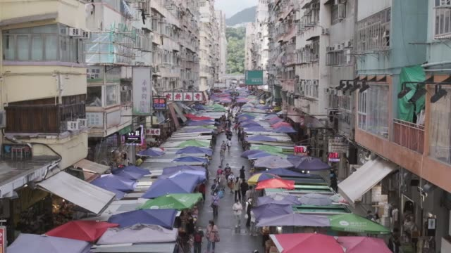 17 sept 2020 - Hong Kong: Fa Yuen Street, the old market in downtown, Shopping area in Hong Kong, during COVID-19 period 17 sept 2020 - Hong Kong: Fa Yuen Street, the old market in downtown, Shopping area in Hong Kong, during COVID-19 period souvenir stock videos & royalty-free footage
