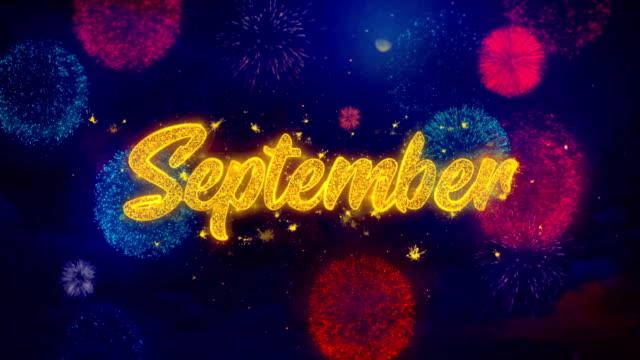 vídeos de stock e filmes b-roll de september greeting text sparkle particles on colored fireworks - setembro