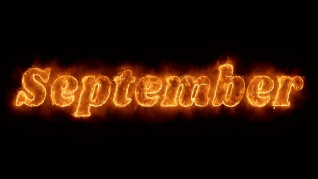 vídeos de stock e filmes b-roll de september word hot animated burning realistic fire flame loop. - setembro
