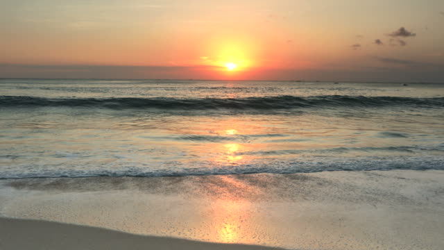 Serene sunset on a tropical beach with breaking waves video