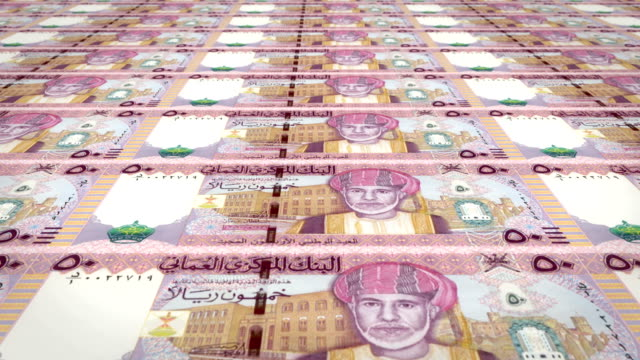 Series of banknotes of fifty omani rials of the Central Bank of Oman rolling on screen, coins of the world, cash money, loop video