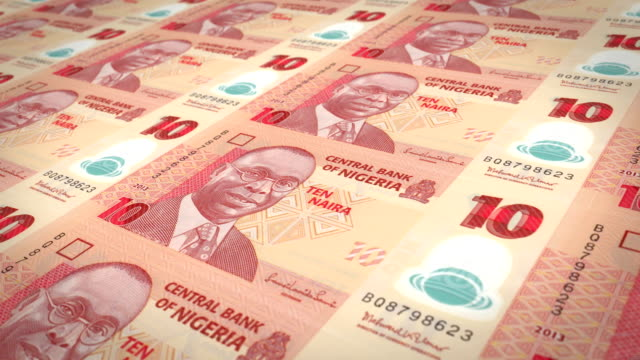 Series of banknotes of ten nigerian naira of the Central Bank of Nigeria rolling on screen, coins of the world, cash money, loop video