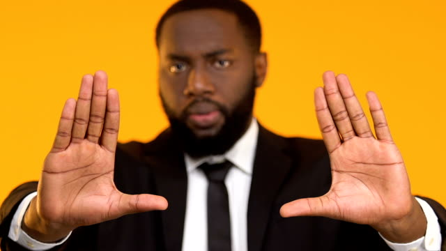 Serious Afro-American business man showing stop gesture, labor rights, work Serious Afro-American business man showing stop gesture, labor rights, work civil rights stock videos & royalty-free footage