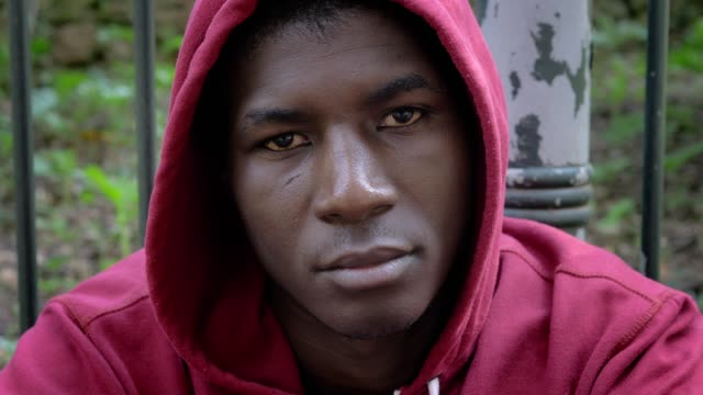 serious confident american african hooded man staring at camera-outdoor serious confident american african hooded man staring at camera-outdoor sweatshirt stock videos & royalty-free footage