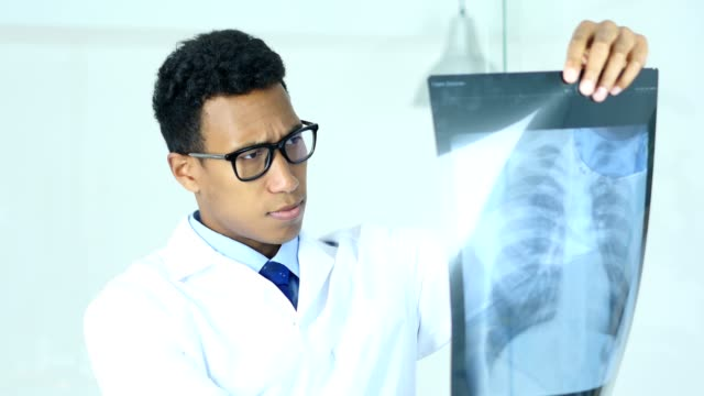 serious doctor examing x-ray of patient, lungs and ribcage - torace umano video stock e b–roll