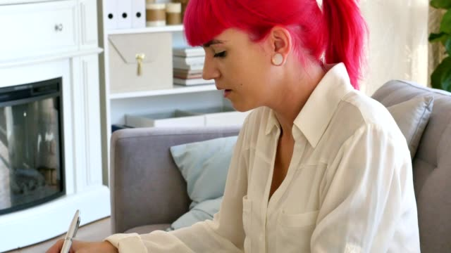 Serious female college student studies at home video
