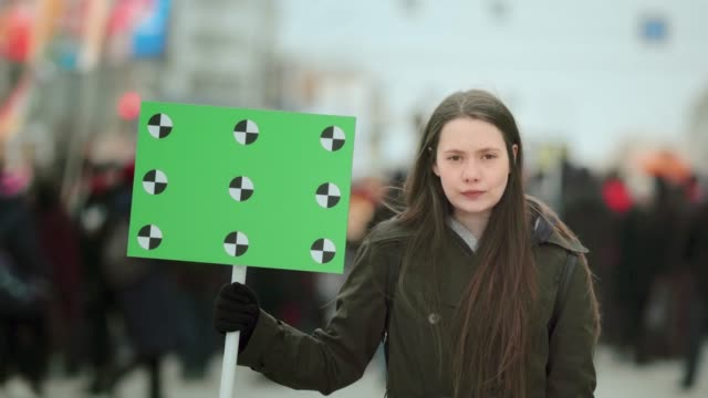 Serious girl with blank poster copyspace. Empty banner. Placard copy space. video