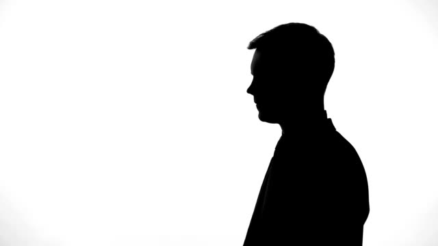 serious man silhouette thinking over creative idea, startup, business planning - uomo nostalgia video stock e b–roll