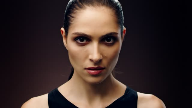 Serious middle eastern ethnicity woman skin care