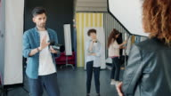istock Serious photographer taking pictures of mixed race model in studio talking using camera 1211979186