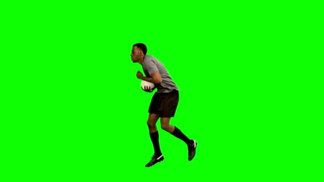 ラグビー選手なランニングにボール ビデオ