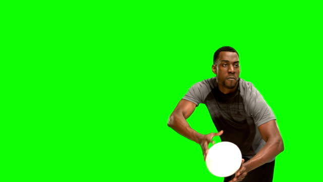 Serious rugby player throwing ball Serious rugby player throwing ball on green screen background rugby stock videos & royalty-free footage