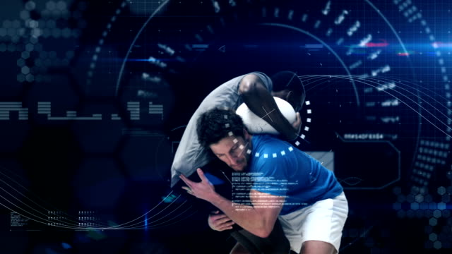 Serious rugby players tackling for ball Serious rugby players tackling for ball against digitally generated background rugby stock videos & royalty-free footage