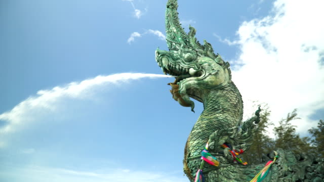 serpent king statue with beautiful sky video