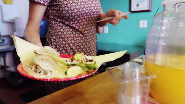Server Handing Over Food in Taqueria video