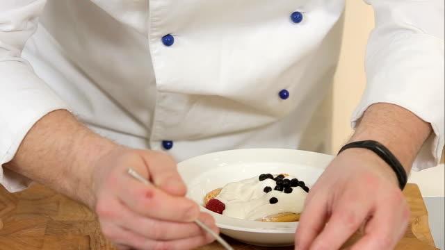 Serving biscuit dessert with berries video