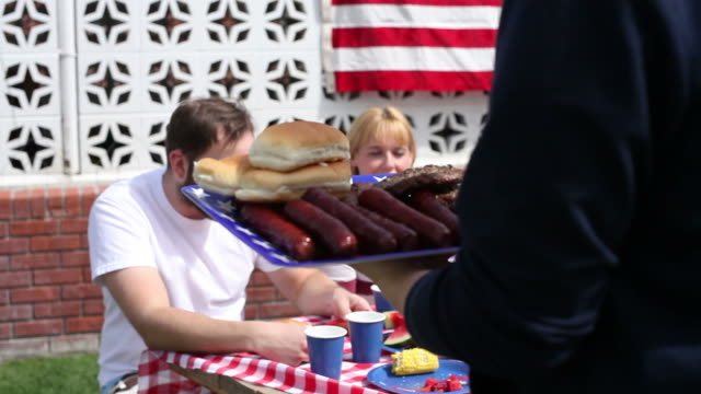 Serving food at family barbecue  family 4th of july stock videos & royalty-free footage