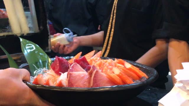 Serving sashimi set to customer , Bangkok , Thailand. Fresh sashimi in big bowl set. sashimi stock videos & royalty-free footage