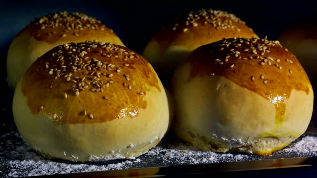 Sesame seeds buns being baked video