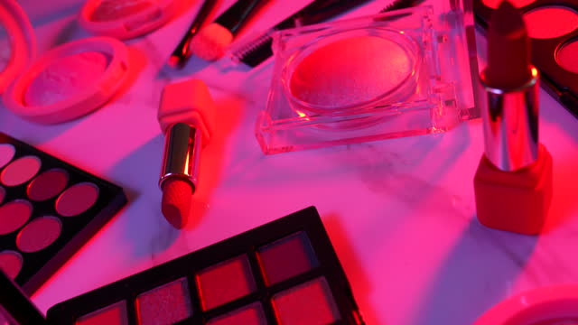 Set makeup cosmetics with neon light Set makeup cosmetics with neon light on marble background and dolly shot mascara stock videos & royalty-free footage