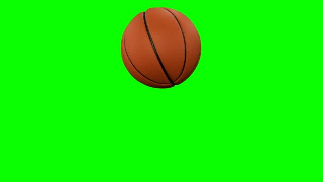 satz von 2 videos. schönen basketball ball trifft die kamera in zeitlupe auf green-screen. basketball 3d-animationen von fliegenden ball. 4k uhd 3840 x 2160. - trefferversuch stock-videos und b-roll-filmmaterial