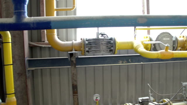 Set of gas pipes in the area Set of gas pipes inside the factory gas pipe stock videos & royalty-free footage