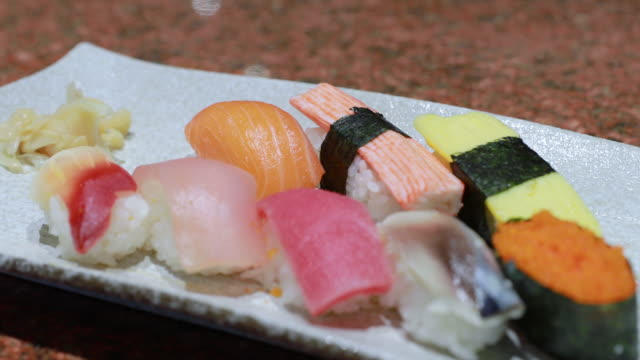 set of mix japanese sushi served on plate - sashimi video stock e b–roll