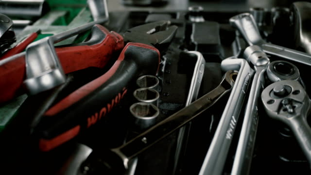 A set of tools for repair Disassembled car at the car service video