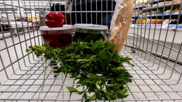 a set of traditional everyday products in the supermarket cart, time lapse,hyper lapse - полный стоковые видео и кадры b-roll