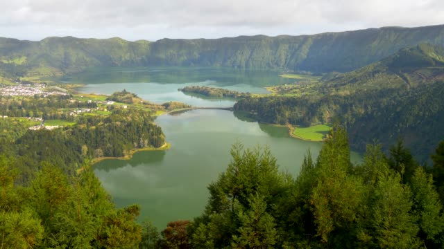vídeos de stock e filmes b-roll de sete cidades, civil parish, that is likewise located in the center of a massive volcanic crater with lake, also referred to as sete cidades. sao miguel island, portuguese archipelago of the azores - açores