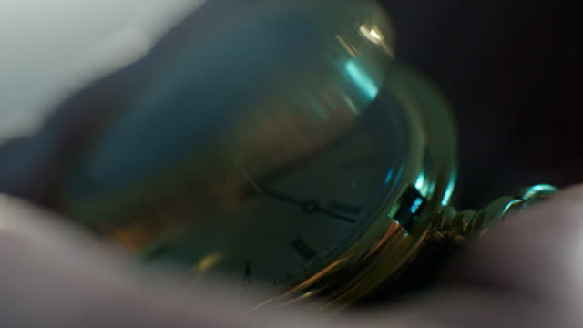 Setting Classic Pocket Watch Ticking in Slow Motion. Small pocket clock in man hands close up. Close-up of hand opening pocket watch. Macro shot video