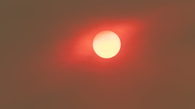Setting Sun Obscurred by Forest Fire Smoke, Sydney, Australia Sydney, Australia - December 6, 2019: The setting sun obscurred by smoke and haze from the forest fires around Sydney, Australia.  This period of poor air quality has been both the longest and most widespread on record. heat haze stock videos & royalty-free footage