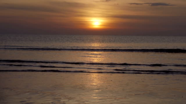Setting Sun Over Perfectly Calm Sandy Beach video