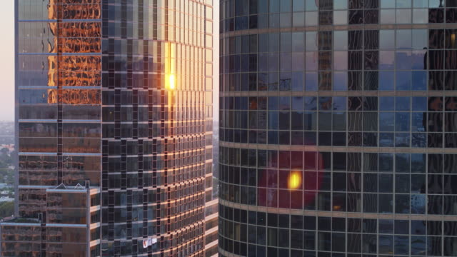 Setting Sun Shining on Curved Modern Office Towers - Drone Shot video
