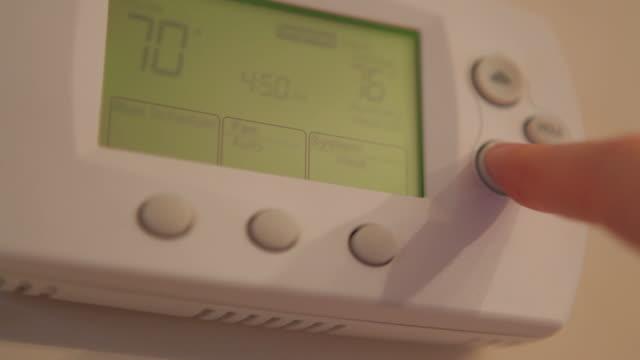 stockvideo's en b-roll-footage met setting thermostat - omgeving