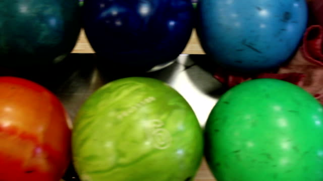 Several bowling balls in set video