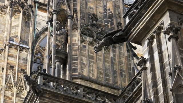 several gargoyles on st vitus cathedral in prague castle - gargoyle video stock e b–roll