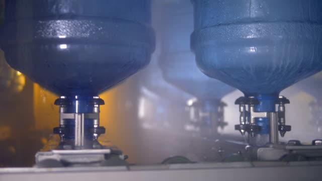 Several overturned water cooler bottles during washing. video