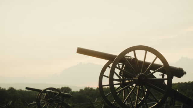 Several US Civil War Cannons from Gettysburg National Military Park, Pennsylvania on a Hazy Day at Sunset