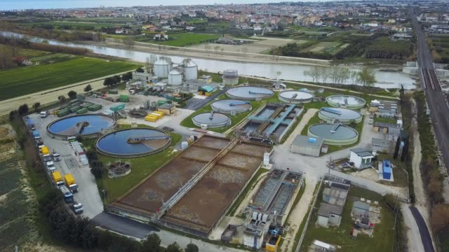 sewage treatment factory in italy - aerial view - acquedotto video stock e b–roll