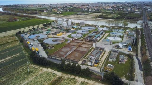 sewage treatment factory in italy - aerial view - биомасса возобновляемая энергия стоковые видео и кадры b-roll