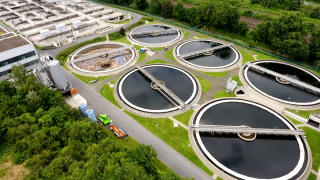 Sewage treatment plant Sewage treatment plant - aerial view purified water stock videos & royalty-free footage