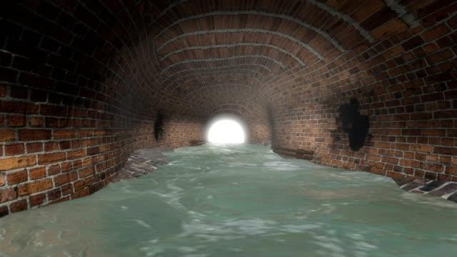 vídeos y material grabado en eventos de stock de túnel de la alcantarilla con luz al final - tubería